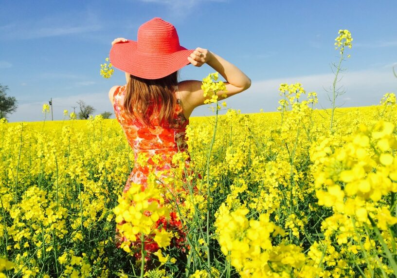 Young Woman Wearing Red Summer Dress And Hat In A Field Of Canola Flowers T20 LWNaVo